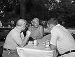 Bethel Park PA:  View of head football coach Rudy Andabaker talking with Jim Hannigan and Big Jim Westhoff during the annual Bethel Park Athletic Association picnic at Lyons Park.  <br /> The picnic gave the Bethel Park boosters a chance to meet the football team and coaches.