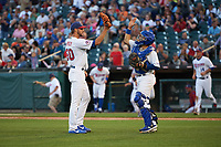 Buffalo Bisons relief pitcher Matt Dermody (50) high fives catcher Raffy Lopez (43) after closing out a game against the Syracuse Chiefs on July 3, 2017 at Coca-Cola Field in Buffalo, New York.  Buffalo defeated Syracuse 6-2.  (Mike Janes/Four Seam Images)