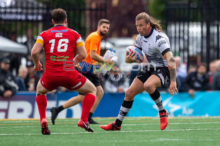Picture by Kevin Sousa/SWpix.com - 07/10/2018 - Rugby League - Betfred Super League - The Qualifiers - Million Pound Game - Toronto Wolfpack v London Broncos - Lamport Stadium, Toronto, Canada - Ashton Sims #10 of the Toronto Wolfpack runs with the ball.