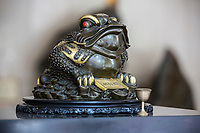 Suzhou, Jiangsu, China.  Replica of a Toad on a Hotel Check-in Desk, a Traditional Symbol of Prosperity.