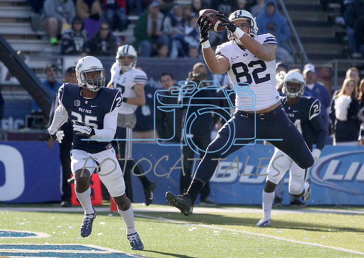 BYU's Kaneakua Friel catches a touchdown pass against Nevada defender Bryan Lane Jr. during the second half of an NCAA college football game in Reno, Nev., on Saturday, Nov. 30, 2013. BYU defeated Nevada 28-23. (AP Photo/Cathleen Allison)