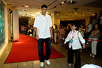 NBA Houston Rockets player Yao Ming walk past a group of  journalists to press conference site for the 2007 Special Olympics in Beijing, China.  July 21, 2006. (photo by Lou Linwei/Sinopix)