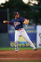 Lowell Spinners third baseman Aneudis Peralta (5) warmup throw to first during a game against the Batavia Muckdogs on August 12, 2015 at Dwyer Stadium in Batavia, New York.  Batavia defeated Lowell 6-4.  (Mike Janes/Four Seam Images)