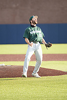 Michigan State Spartans pitcher Zach Iverson (32) celebrates the last out against the Michigan Wolverines on March 22, 2021 in NCAA baseball action at Ray Fisher Stadium in Ann Arbor, Michigan. Michigan State beat the Wolverines 3-0. (Andrew Woolley/Four Seam Images)