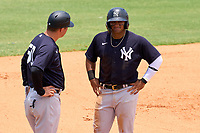FCL Yankees Jasson Dominguez (25) talks with manager Tyson Blaser (50) during a game against the FCL Tigers on June 28, 2021 at Tigertown in Lakeland, Florida.  (Mike Janes/Four Seam Images)