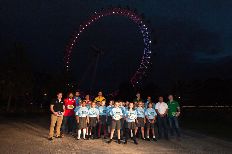 Chase Bridge Choir sing World in Union in front of the London Eye for the launch of the Rugby World Cup England 2015 with Adam Jones (Wales), James Horwill (Australia), Masaaki Sakata (Japan), Bob Skinstad (South Africa), Jason Robinson (England), Gonzalo Camacho (Argentina), Marco Bortolami (Italy), Gordon D'Arcy (Ireland) and Andrew Mehrtens (New Zealand)  - 15/09/2015 - London Eye - London <br /> Mandatory Credit: Rob Munro/Stewart Communications