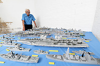 BNPS.co.uk (01202) 558833<br /> Pic: ZacharyCulpin/BNPS<br /> <br /> Pictured: The models are on display at a new exhibition at the Nothe Fort in Weymouth<br /> <br /> A master modeller who was inundated with hundreds of rare matchboxes after appealing for donations has used them to build a 3ft long aircraft carrier.<br /> <br /> Now Philip Warren has added the impressive model to his so-called matchbox fleet of miniature ships which have gone on display in an exhibition.<br /> <br /> Mr Warren's 72 year pastime of building model warships had looked as though it had come to an end earlier this year when he ran out of the traditional wooden boxes he used to make the hull and decks.<br /> <br /> But the 90-year-old was sent more than 300 of the lightweight matchboxes made from aspen wood in response to his plea for more.