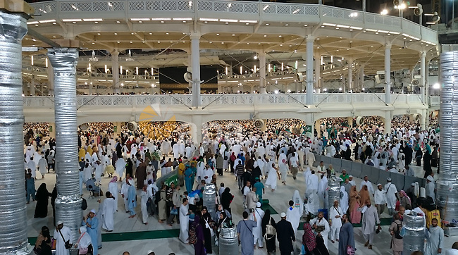 """Muslim pilgrims attend the 16th conference of """"Muslim youth and Media"""" during the annual haj pilgrimage in Mecca September 19, 2015. According to the Muslims holy book the Koran, the Kaaba was built by Abraham and his son Ismael, after Ismael had settled in Arabia. Millions of Muslims have arrived in Saudi Arabia to perform their Haj . Photo by Stringer"""