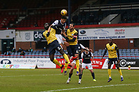 20th February 2021; Dens Park, Dundee, Scotland; Scottish Championship Football, Dundee FC versus Queen of the South; Osman Sow of Dundee competes in the air with Ayo Obileye and Gregor Buchanan of Queen of the South