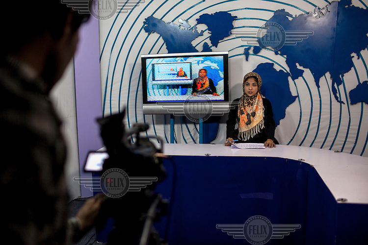 An Afghan woman broadcasts in the Television at Herat /Felix Features