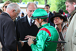 09-11-11 : Sarafina's team before the race, from left to right, trainer Alain de Royer Dupré, his Highness Karim Aga Khan the owner and his daughter princess Zara, his manager Georges Rimaud surrounding jockey Christophe-Patrice Lemaire