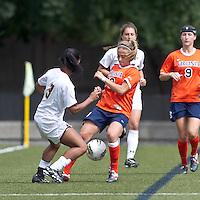 University of Virginia forward Caroline Miller (10) battles for the ball at midfield. Boston College defeated University of Virginia, 2-0, at the Newton Soccer Field, on September 18, 2011.