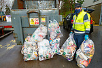 Donal O'Mahoney loading the plastic recycling into the bins at the Milltown Recycling and Waste Disposal Centre