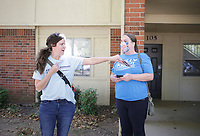 Kelly Krout (from left) and friend Sofie Dill drip off info cards as she campaigns, Friday, October 16, 2020 at The Links apartment complex in Lowell. Krout is running in the House district 90 race in Rogers/Lowell. Check out nwaonline.com/2010018Daily/ for today's photo gallery. <br /> (NWA Democrat-Gazette/Charlie Kaijo)