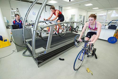 22 MAR 2012 - LOUGHBOROUGH, GBR - British triathletes Lucy Hall (right) and Abbie Thorrington (centre) train in the Performance Lab at Loughborough University watched by British Triathlon's Performance Coach Mark Pearce (PHOTO (C) 2012 NIGEL FARROW)