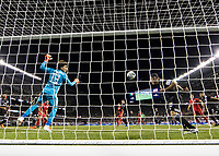 CHICAGO, IL - JULY 7: A header by Jordan Morris #11 goes towards the goal as Guillermo Ochoa #13 and Andres Guardado #18 watch during a game between Mexico and USMNT at Soldier Field on July 7, 2019 in Chicago, Illinois.