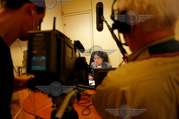 Radio journalist Nam khan Kaen transmits a program to Burma. Democratic Voice of Burma is radio and TV station run by exiled Burmese. Opposing the government, the DVB has been transmitting, from the Norwegian capitol Oslo, into Burma since 1992.