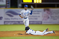 Burlington Royals shortstop Maikel Garcia (2) fields a throw as Robert Javier (33) of the Pulaski Yankees slides into second base at Calfee Park on September 1, 2019 in Pulaski, Virginia. The Royals defeated the Yankees 5-4 in 17 innings. (Brian Westerholt/Four Seam Images)
