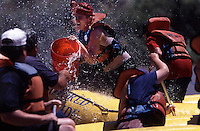Rafters horse around  on the Green River in Moab, Utah. River rafting draws school groups and church groups for half day to three day outings.  BLM administers permits for rafting companies and also private groups which are done by a lottery--all in an effort to control the numbers.  The Moab Daily as its called, is an easy trip on the Colorado River with a half dozen rapids to give a thrill to the mostly flat, slow river...