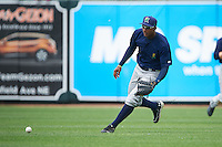 Cedar Rapids Kernels outfielder Edgar Corcino (36) fields a base hit during a game against the West Michigan Whitecaps on June 7, 2015 at Fifth Third Ballpark in Comstock Park, Michigan.  West Michigan defeated Cedar Rapids 6-2.  (Mike Janes/Four Seam Images)