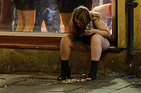 Pictured: A woman is sick in Swansea. Tuesday 31 December 2019 to Wednesday 01 January 2020<br /> Re: Revellers on a night out for New Year's Eve in Wind Street, Swansea, Wales, UK.