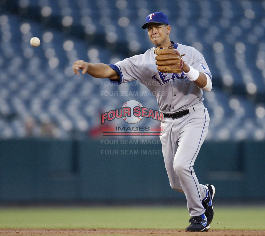 Alex Rodriguez of the Texas Rangers makes a throw during a 2002 MLB season game against the Los Angeles Angels at Angel Stadium, in Los Angeles, California. (Larry Goren/Four Seam Images)