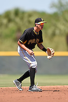 Pittsburgh Pirates shorstop Cole Tucker (12) during a minor league spring training game against the Toronto Blue Jays on March 21, 2015 at Pirate City in Bradenton, Florida.  (Mike Janes/Four Seam Images)