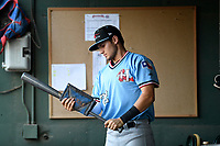 Second baseman Kole Enright (22) of the Hickory Crawdads puts pine tar on his bat in the dugout before a game against the Greenville Drive on Monday, August 20, 2018, at Fluor Field at the West End in Greenville, South Carolina. Hickory won, 11-2. (Tom Priddy/Four Seam Images)