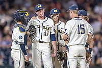 Michigan Wolverines pitcher Tommy Henry (47) waits with his teammates (L to R) Joe Donovan, Blake Nelson, Jack Blomgren and Jimmy Kerr before being replaced against the Vanderbilt Commodores during Game 1 of the NCAA College World Series Finals on June 24, 2019 at TD Ameritrade Park in Omaha, Nebraska. Michigan defeated Vanderbilt 7-4. (Andrew Woolley/Four Seam Images)