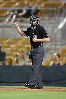 Umpire Ian Fazio during an Arizona Fall League game between the Peoria Javelinas and Glendale Desert Dogs on October 13, 2014 at Camelback Ranch in Phoenix, Arizona.  The game ended in a tie, 2-2.  (Mike Janes/Four Seam Images)
