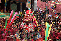 Masked dancers tame demons & negativity  at the Monlam Chenpo, Katok Dorjeden Monastery - Kham, (Tibet), Sichuan, China