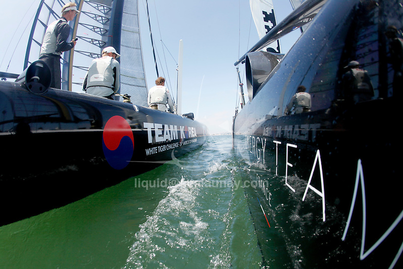 America's Cup, onboard the AC 45 Energy Team in preparation the start of the America's Cup World Series in Cascais Portugal during a passage between Lisbon and Cascais. Training match racing with the Korean Team.