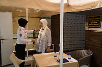 A security guard checks a guest at a checkpoint outside the women only area at the Wome Deluxe hotel in Alanya. Phones and cameras are forbidden in the women's area, so guests must be checked before entering.