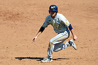 Michigan Wolverines infielder John DiLaura #12 leads off first during an exhibition game against the New York Mets at Tradition Field on February 24, 2013 in St. Lucie, Florida.  New York defeated Michigan 5-2.  (Mike Janes/Four Seam Images)