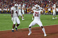 LOS ANGELES, CA - SEPTEMBER 11: Kendall Williamson #21 and Thomas Booker #4 of the Stanford Cardinal react to a pick-six by Kyu Blu Kelly #17 during a game between University of Southern California and Stanford Football at Los Angeles Memorial Coliseum on September 11, 2021 in Los Angeles, California.