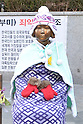 Statue of Korean Comfort Woman in front of the Embassy of Japan in Seoul