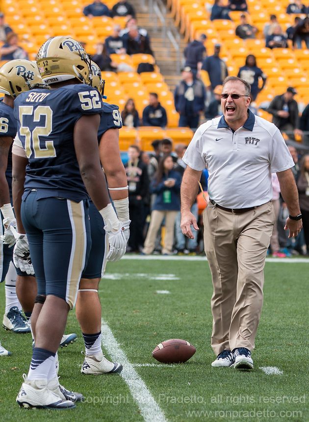 Pitt head coach Pat Narduzzi encourages the team before the game. The Miami Hurricanes football team defeated the Pitt Panthers 29-24 on  Friday, November 27, 2015 at Heinz Field, Pittsburgh, Pennsylvania.