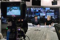 """RUSSLAND, 11.2012. Moskau.  Oppositioneller Fernsehsender Doschd (""""optimistischer Kanal""""), gegruendet von Natalja Sindejewa und Alexander Winokurow. Die Studios befinden sich in der ehemaligen Schokoladenfabrik """"Roter Oktober"""". Unter der Leitung von Sindejewa wird das Studioleben von jungen Frauen gepraegt. – Nachrichtensendung.   Oppositional TV-station Dozhd (""""optimistic channel""""), founded by Natalya Sindeyeva and Aleksandr Vinokurov. The studios are located in the famous former chocolate factory """"Red October"""". Led by Sindeyeva young women dominate studio life. – News broadcast. © Martin Fejer/EST&OST"""