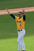 Head coach Link Jarrett (5) of the UNC Greensboro Spartans acknowledges the fans after a game against the Furman Paladins in the title game of the Southern Conference Championship series on Sunday, May 28, 2017, at Fluor Field at the West End in Greenville, South Carolina. UNCG won, 13-1. (Tom Priddy/Four Seam Images)