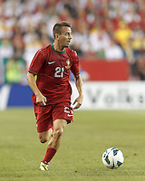 Portugal defender Joao Pereira (21) looks to pass. In an international friendly, Brazil (yellow/blue) defeated Portugal (red), 3-1, at Gillette Stadium on September 10, 2013.