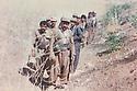 Iraq 1989 .In the mountain of Suren, near the Iranian border, Mahmoud Sangawi with his peshmergas on the track .Irak 1989 .Dans les montagne de Suren, pres de la frontiere iranienne, Mahmoud Sangawy avec ses peshmergas sur la piste