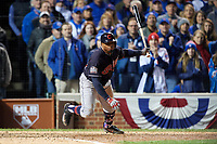 Cleveland Indians Rajai Davis (20) hits a single in the eighth inning during Game 5 of the Major League Baseball World Series against the Chicago Cubs on October 30, 2016 at Wrigley Field in Chicago, Illinois.  (Mike Janes/Four Seam Images)