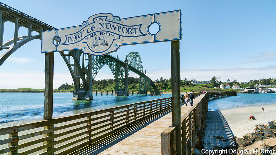 Port of Newport, Yaquina Bay Bridge, U.S. Highway 101, Pacific Coast Scenic Byway, near Newport, Oregon.  Oregon Central Coast, beaches, bays, bars, family fun, winter storms, lighthouses, fishing boats, bluffs, fossils and beach walks.