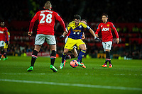 Sunday 05 January 2014<br /> Pictured:Alejandro Pozuelo tries to get the ball past Alexander B?ttner of Manchester United<br /> Re: Manchester Utd FC v Swansea City FA cup third round match at Old Trafford, Manchester