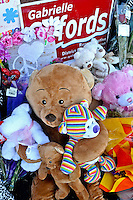 There were so many Teddy Bears and other stuffed animals being left at the three shrines they were removed and given out at the local hospitals. They simply reappeared and more were distributed and more returned as the Tucson Community fought to find its soul after such a infamous event, many turned to helping others. At years end the Tucson Toy Drive enjoyed a historic $300,000 toy drive for a Southern Arizona record.