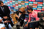 Urbano Cairo RCS and Tonina Pantani, mother of Marco Pantani, holding the Trofeo Senza Fine with race leader Egan Bernal (COL) Ineos Grenadiers at the end of Stage 17 of the 2021 Giro d'Italia, running 193km from Canazei to Sega Di Ala, Italy. 26th May 2021.  <br /> Picture: LaPresse/Massimo Paolone   Cyclefile<br /> <br /> All photos usage must carry mandatory copyright credit (© Cyclefile   Massimo Paolone/LaPresse)