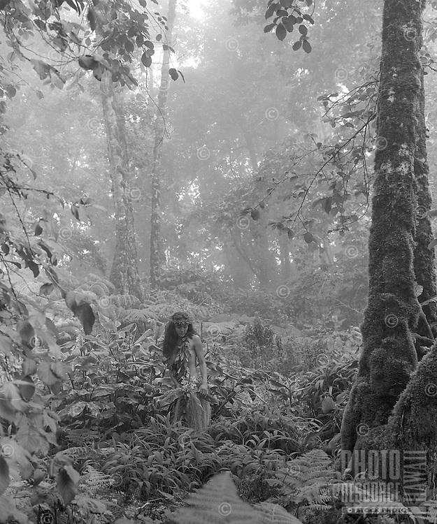 Young Hawaiian girl in the forest near Waimea in the Kohala mountains.