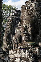 View of three face towers of The Bayon at Angkor Thom, the largest Khmer city ever built, are part of the Angkor Wat complex  -  Siem Reap, Cambodia....