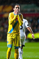 Swansea, UK. Thursday 20 February 2014<br /> Pictured: Jose Callejon of Napoli holds his face after  missing  shot at goal <br /> Re: UEFA Europa League, Swansea City FC v SSC Napoli at the Liberty Stadium, south Wales, UK