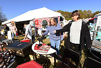 """CRAFTS BESIDE THE CREEK<br />Dette Morgan (cq) (from left), Shelly King and Kathy Garoutte, all of Bella Vista, shop for craft items on Wednesday Oct. 14 2020 at the 14th annual Spanker Creek Farm arts and crafts fair. The fair runs through Sunday at the farm on McNelly Road one-half mile east of U.S. 71 near Bentonville and Bella Vista. Admission is free. The """"It's Fall Y'all"""" crafts fair starts to day at the Benton County fairgrounds. Go to nwaonline.com/201015daily/ to see more photos.<br />(NWA Democrat-Gazette/Flip Putthoff"""